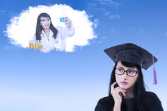 Graduate woman daydreaming Royalty Free Stock Photos