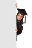 Graduate woman holding placard Stock Photo