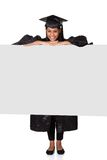 Graduate woman holding placard Royalty Free Stock Photo