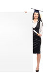 A graduate woman holding a white banner Royalty Free Stock Photos