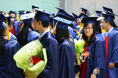 Graduate,  young human resources. HO CHI MINH CITY, VIETNAM- AUG 8 : Group of student in gown uniform standing, wait for graduate ceremony at university, young Royalty Free Stock Photos