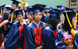 Graduate,  young human resources. HO CHI MINH CITY, VIETNAM- AUG 8 : Group of student in gown uniform standing, wait for graduate ceremony at university, young Stock Photo
