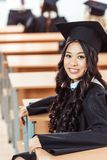 Graduated asian student girl sitting. At class royalty free stock photography
