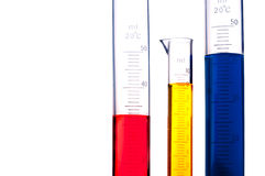 Graduated cylinders of colored chemicals Stock Photos