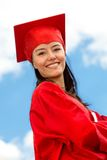 Graduated female in gown Royalty Free Stock Images