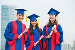 Graduated friends Stock Images