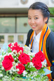 Graduated girl with red rose Stock Photos