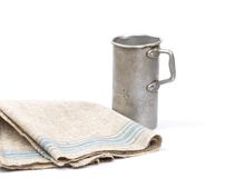 Graduated jug and linen Stock Photos