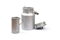Graduated jug and milk can Stock Photos