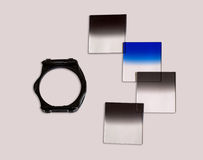 Graduated Neutral density filters for camera with holder used for photography isolated. Stock Photo