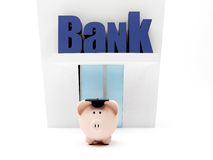 Graduated piggybank at the bank Stock Image