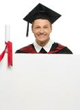 Graduated student man with notice board Stock Images
