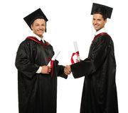 Graduated student men shaking hands Stock Photos