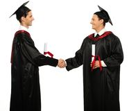 Graduated student men shaking hands Royalty Free Stock Photo