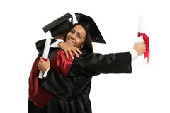 Graduated students girls hugging Royalty Free Stock Photos