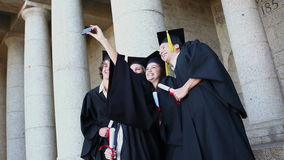 Graduated students taking themselves in picture Royalty Free Stock Image