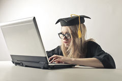 Graduated woman at the laptop Royalty Free Stock Photos