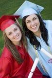 Graduates. Smiling Graduates royalty free stock images