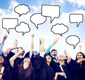 Graduates Arms Raised With Speech Bubbles Royalty Free Stock Photo