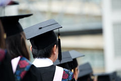 Graduates. Back of graduates during commencement Stock Images