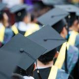 Graduates. Back of graduates during commencement Stock Photo