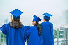 Graduates on balcony Royalty Free Stock Photos