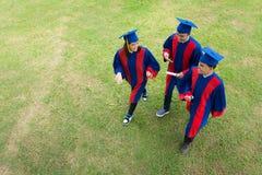 Graduates on campus Royalty Free Stock Image