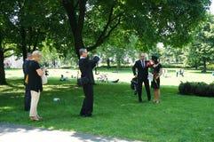 Graduates celebrating at a park Royalty Free Stock Images
