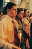 Graduates in the church. KIVERCI, UKRAINE - June 26, 2009: Sanctifies graduates in the church Royalty Free Stock Image