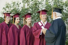 Graduates Collecting Certificate From Dean Royalty Free Stock Image