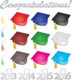 Graduates. Congratulations graduates multicolored caps and tassles Royalty Free Stock Photography