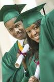 Graduates with diplomas outside Stock Photo