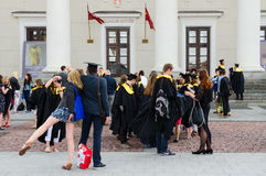 Graduates of the European Humanities University near the Town Ha. VILNIUS, LITHUANIA - JULY 10, 2015: Graduates of the European Humanities University after the Stock Photography