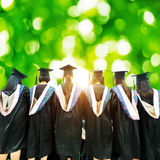 Graduates face the morning sun Stock Image