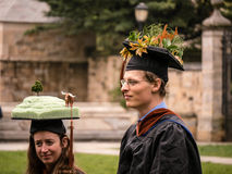Graduates with funny hats Stock Images