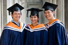 Graduates In Hallway Stock Photo