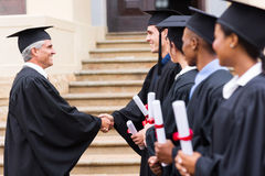 Graduates handshaking dean Royalty Free Stock Photography