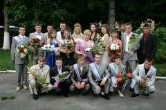 Graduates. KIVERCI, UKRAINE - 27 June 2009: Group of graduates at park Stock Image