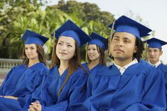 Graduates listening to ceremony Royalty Free Stock Image