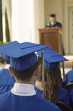 Graduates Listening To Speaker Outside Royalty Free Stock Photo