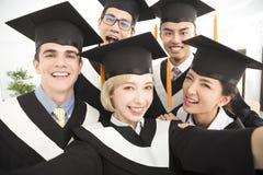 graduates making selfie photo in classroom Stock Photos