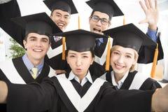 Graduates making selfie photo in classroom Royalty Free Stock Photo