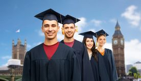 Graduates in mortar boards and bachelor gowns royalty free stock images