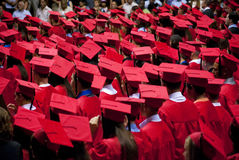 Graduates Red Cap and Gown Royalty Free Stock Photos