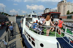 Graduates of schools on tours of the Moscow river on a pleasure boat. Royalty Free Stock Photo