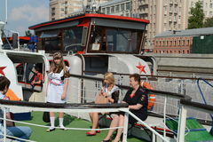 Graduates of schools on tours of the Moscow river on a pleasure boat. Stock Photo