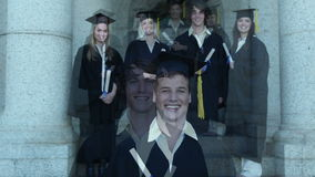 Graduates smiling as they pose stock video