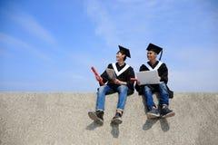 Graduates student use computer Royalty Free Stock Image