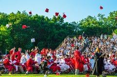 Graduates Toss Caps Stock Photos