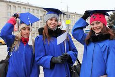 Graduates of the University in the mantles Royalty Free Stock Photo